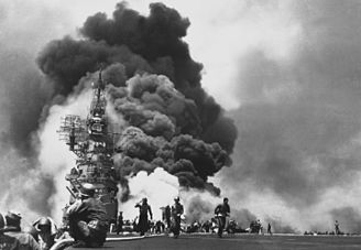 During the Battle of Okinawa, kamikazes attack USS Bunker Hill.